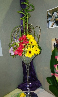 Contemporary look of gerbera, alstromeria, freesia & iris with flexi grass
