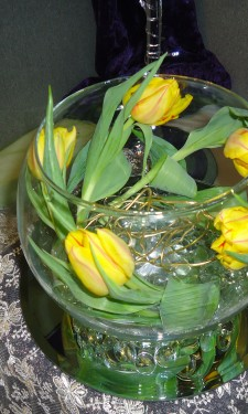 Tulips in goldfish bowl with gold wire decoration