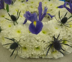 White wreath with blue iris