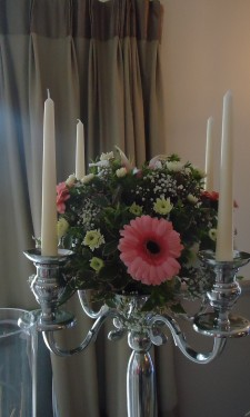 Candelabra arrangement with pink gerbera, spray chrysanthemums and gypsophila