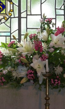 Altar arrangement of ivory lily, astilbe, pink bouvardia, antirrhinum, and Solomon's seal