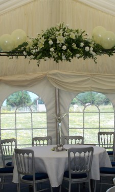 Balloon arch and ivory silk flower centre piece