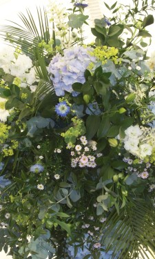 Large arrangement supended from marquee frame with Hydrangea, ivory gerbera & September flower