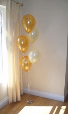 Gold and ivory balloon bouquet