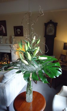 Oriental lilies, monstera leaves and sisal at Crug Glas