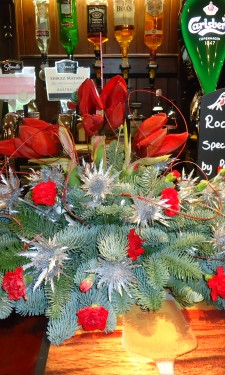 Christmas arrangement of amaryllis, erygium, spray carnations and red ting at The Harp Inn Letterston