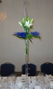 Asiatic lily, monstera leaf and sisal in lily vase with lights