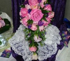 Pink and lilac rose bouquet with purple lizianthus and pink freesia