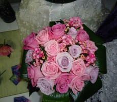 Pink and liac rose with pink bouvardia and aspidistra leaf collar