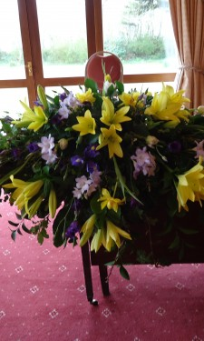 Registrar's table/ top table arrangement of yellow lilies and tulips and purple and lilac freesia