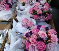 Mixed pink and lilac roses, bouvardia, and purple lizianthus