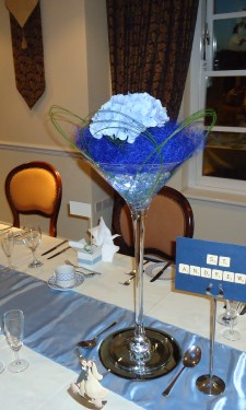 Light blue hydrangea with navy sisal and flexi grass loops in a martini vase