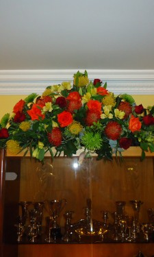 Mixed autumn colours provided by proteas, roses, chrysanthemum and alstromeria
