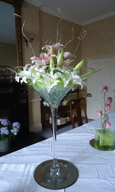 Oriental lilies in Martini vase with flexi grass loops, green sisal & glass nuggets