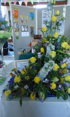 Yellow roses and alstromeria, purple freesia, blue delphiniums