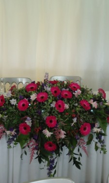 Top table arrangement with gerbera freesia, astilbe, lizianthus & foliage