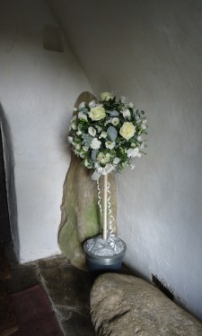 Topiary tree with ivory roses, carnations lizianthus and eucalyptus