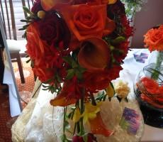 Autumn shades with roses, calla lilies & freesia
