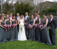 Ivory shower bouquet and mixed pinks and purple hand tied bouquets with ribbon trim