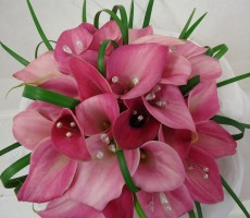 Pink calla Hand tied bouquet with iridescent crystal and looped grass