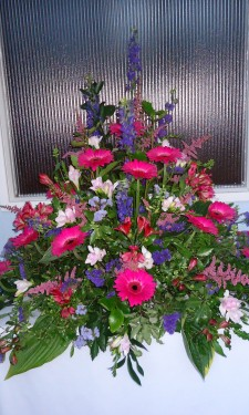 Chapel porch arrangement with pink gerbera, alstromeria and astilbe & purple statice and larkspur