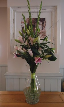 Pink lily and gladiolus in hotel reception