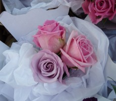 Flower girl's bouquet of mixed pink & lilac roses