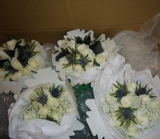 Ivory roses with eryngium and gypsophila