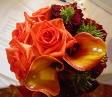 Mixed autumn colours with orange & red roses and Calla lilies with pearl detail