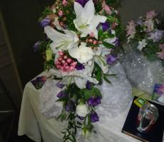 Shower bouquet with white lilies, roses pink bouvardia, & purple lizianthus