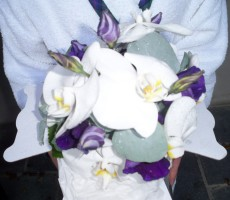 Hand tied with Phalaenopsis orchid and purple lizianthus