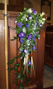 Pew end with purple lizianthus & pink alstromeria