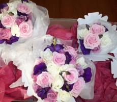 Hand tied bouquets of ivory roses, Heaven roses, aqua roses and purple lizianthus