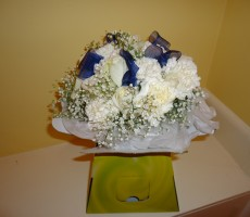 Hand tied bouquet with roses, carnations and gypsophila and navy ribbon detail