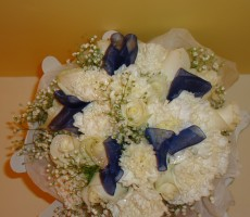 Ivory roses, carnations and gypsophila with navy ribbon detail