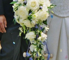 Shower bouquet with roses, freesia, Singapore orchids and blue ribbon