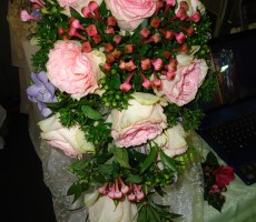 Shower bouquet with roses bouvardia, freesia and soft ruscus