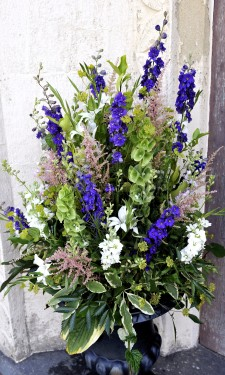 Urn arrangement with mixed flowers