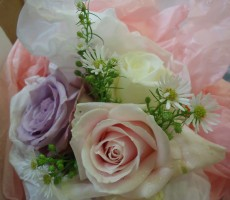 Flower girl posy of mixed roses and aster