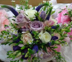 Vintage look hand tied bouquet in pinks and purples