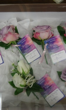 Lilac rose buttonholes & Ivory rose corsage