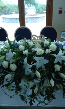 Top table arrangement with Oriental lilies, roses and freesia