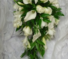 shower bouquet with roses, calla lilies, freesia, rosemary and soft ruscus